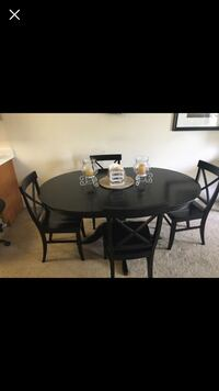 round black wooden table with four chairs dining set San Diego, 92109