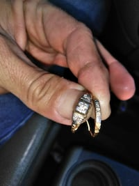 Two 75 year old ten carrot gld and diamand rings.