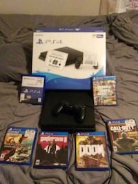 black Sony PS4 console with controller and game cases Calera, 74730