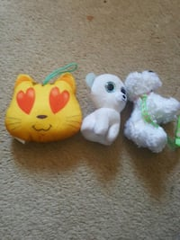 three assorted-color plush toys