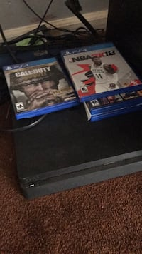 Sony ps4 console with controller and game cases Lithonia, 30058