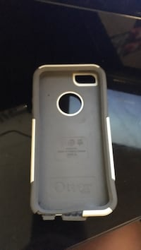 White and grey iPhone 5/5s/se otterbox (corner is broken)