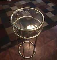 Round stainless steel framed glass top table New York, 10456
