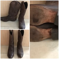 pair of brown leather boots 420 mi