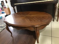 Oval brown wooden coffee table Ormond Beach, 32174