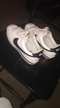 black-and-white Nike low-top sneakers