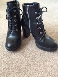 pair of black leather side-zip platform chunky-heeled ankle boots