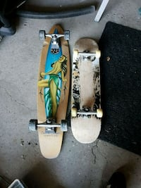 brown and green skateboard with white skateboard Courtice