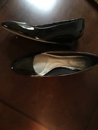 Pair of black leather pumps/ size 8