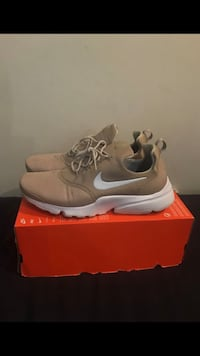 pair of gray Nike running shoes with box Silver Spring, 20906