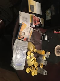 white Medela electric breast pump kit with black bag