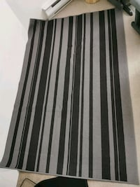 Grey rug with stripes