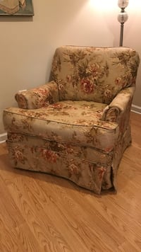 Rocker glider chair. Fabric is worn but the chair is solid   Buford
