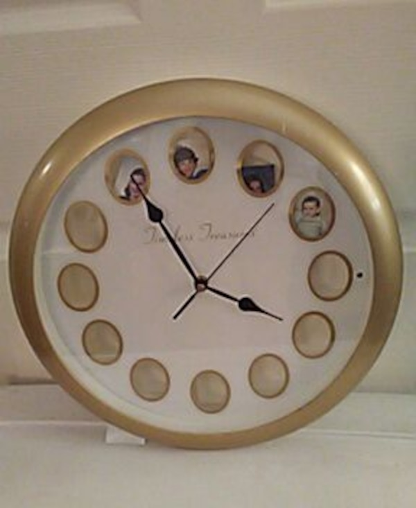 beige analog wall clock with picture panels