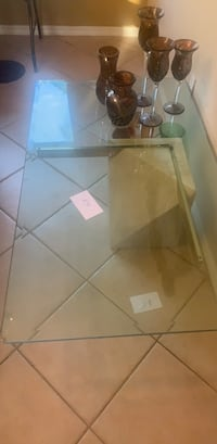 Modern glass table with stone base