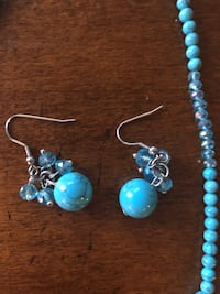 pair of silver-and-blue earrings