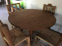 round brown wooden table with four chairs dining set Mesa, 85207