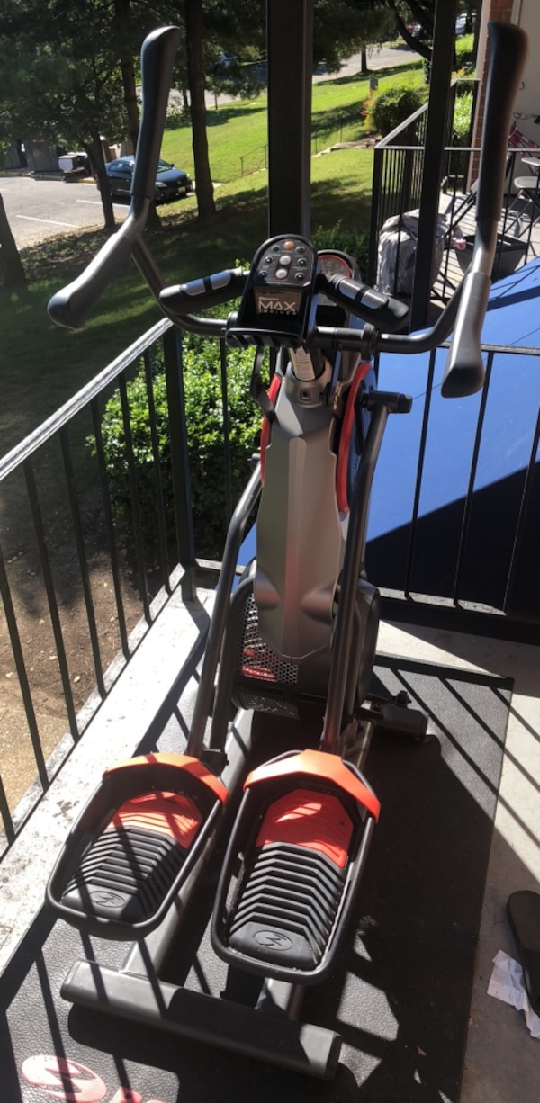 black and red elliptical trainer