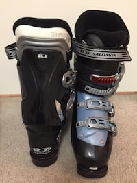 pair of black-and-gray Salomon snowboard boots