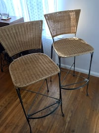 two black metal framed brown wicker chairs West Hollywood, 90046