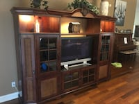 Brown wooden tv hutch with flat screen television TAMPA