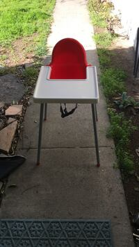 baby's white and red highchair