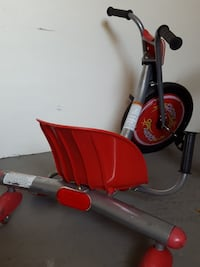red and grey pedal trike