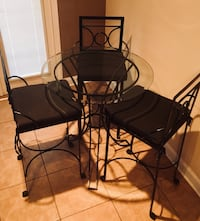 Black Wrought Iron Table and 3 chairs