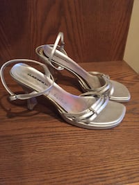 Strappy silver sandals. perfect for the holidays. Size 7.5