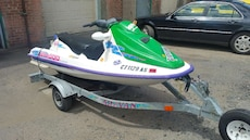 white, green and purple personal watercraft