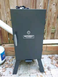 Electric Smoker with cover, owners manual, and wood chips  Springfield, 22151