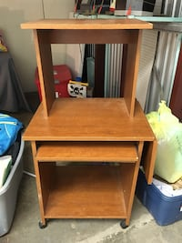 Brown wooden computer desk with hutch