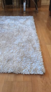 brown and white area rug London, WC1E 6HB