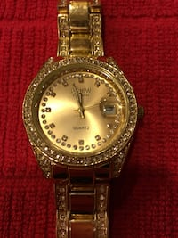 Women's Geneva gold tone watch with crystal accents on dial and band Pensacola, 32504