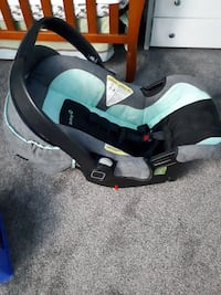 baby's black and green car seat carrier