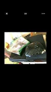 black Xbox One console with controller and game ca Los Angeles, 90063