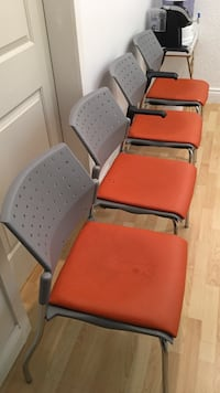 four gray metal chairs with orange seat cushions New Westminster, V3L 1Y3