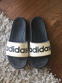 pair of black-and-white Adidas slide sandals Surrey