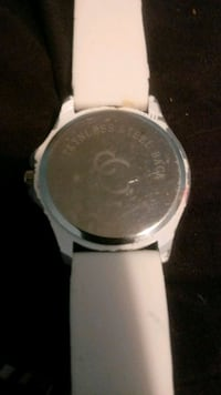 round silver analog watch with white leather strap Kansas City, 64124