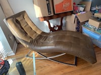 Leather modern lounge chair with chome base. Perfect condition, no damage. We downsized and cannot fit it in our new space. Make an offer!  15 km