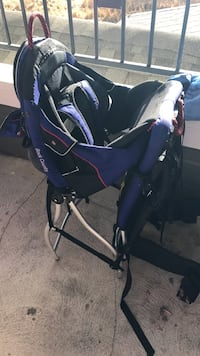 baby's blue and black backpack carrier