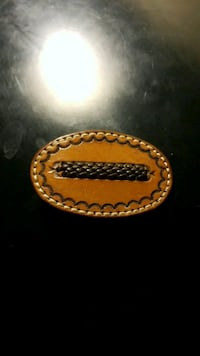 brown and black leather  Belt buckle