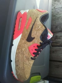 black, brown, and red Nike Air Max shoe