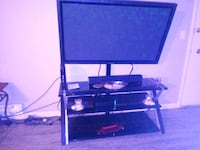 black wooden TV stand with flat screen television Tukwila, 98168