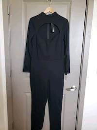Brand New- Black Jumpsuit with front style cut. 1X Frederick