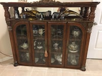 Brown wooden framed glass display China cabinet Fairfax