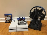 black Sony PS4 console with controller and game cases New York, 11220