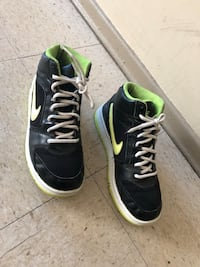 Pair of black-and-green nike sneakers size 6 Winnipeg, R2L 1P8