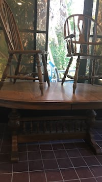 Light brown oak dining room table. JUST REDUCED TO $200. Four leaves of table inside table. Just pull table to release them to enlarge. 772 mi