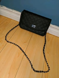 Black crossbody bag with chain strap